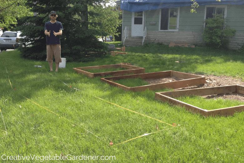 man designing flower bed