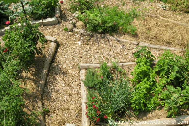 back yard vegetable garden with mulch