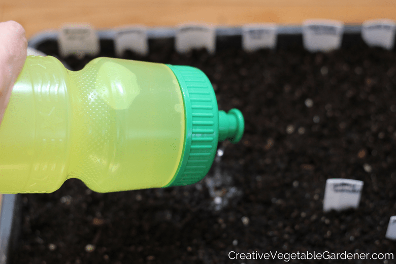use a bike water bottle to water the plants on your grow light stand