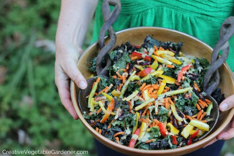 woman holding kale salad