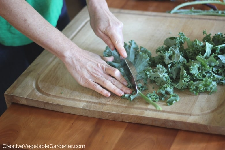 woman chopping kale