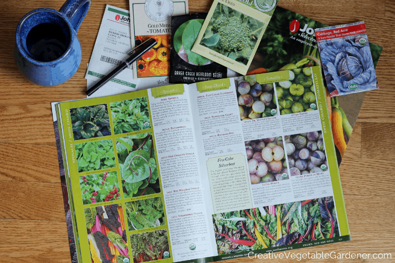 garden catalog spread out with seeds