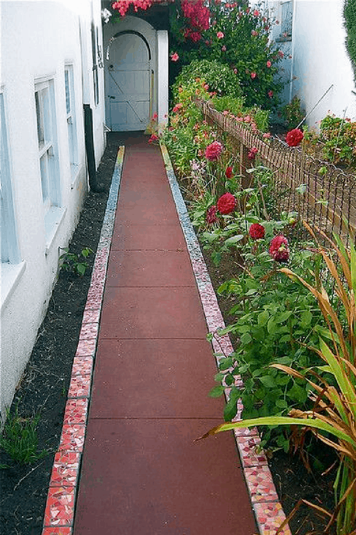 photos of vegetable gardens with mosaic path