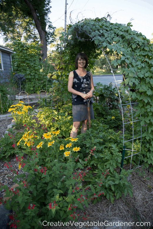 Woman Under Trellis In Photo Of Vegetable Garden