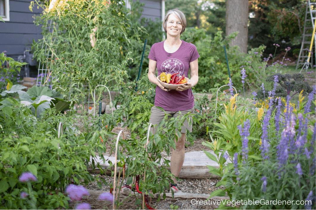 woman holding sweet pepper harvest