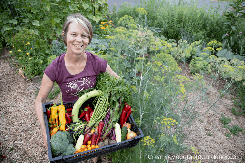 woman with large organic garden harvest